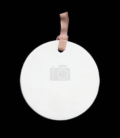 blank white round cardboard label on black background