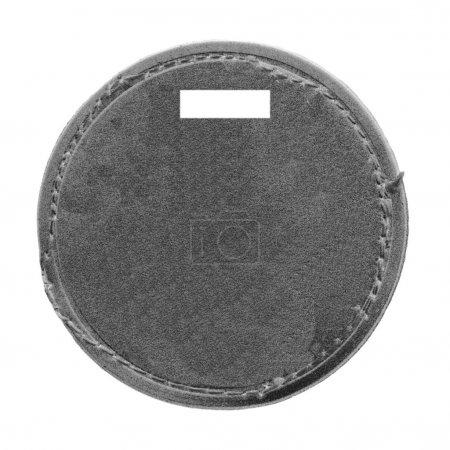 blank dark gray round cardboard label isolated on white