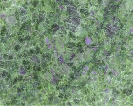 texture of green polished stone with pink inclusions