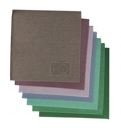 multicolored squares of material stacked together on white