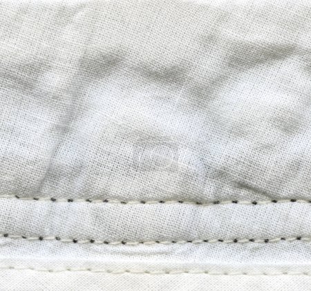 crumpled white textile background,stitches