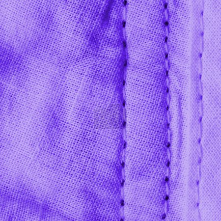 crumpled violet textile background,stitches