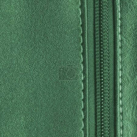 green leather background, decorated with stitches and zipper. Useful for design-works