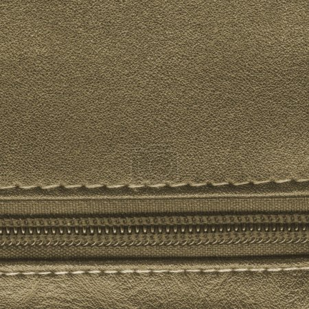brown leather background, decorated with stitches and zipper. Useful for design-works