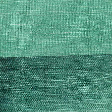 green denim background of two different  tints. Useful for design-works