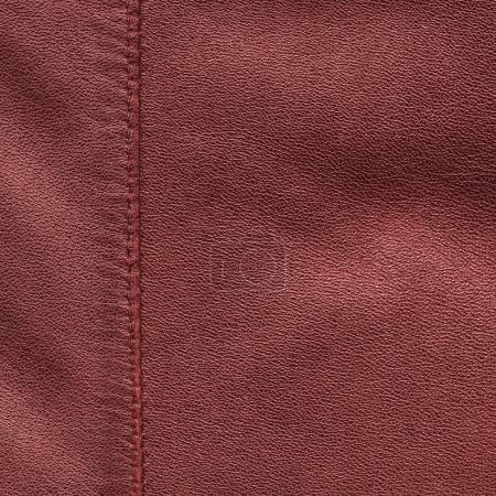 Photo pour Fond en cuir rouge, orné d'une couture - image libre de droit