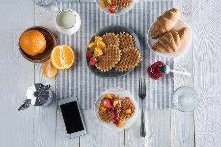 Fresh tasty breakfast with waffles