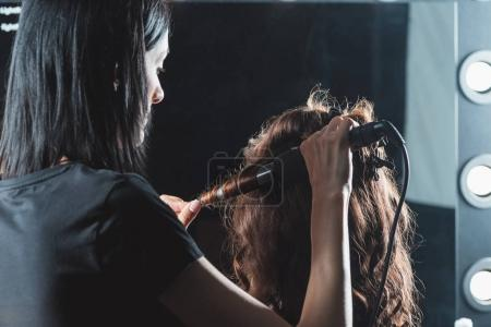 hair dresser doing hairstyle