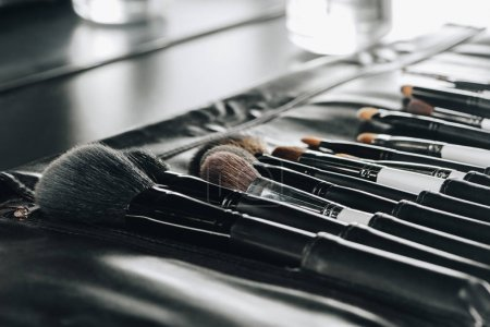 Photo for Close up view of various makeup brushes set in bag - Royalty Free Image