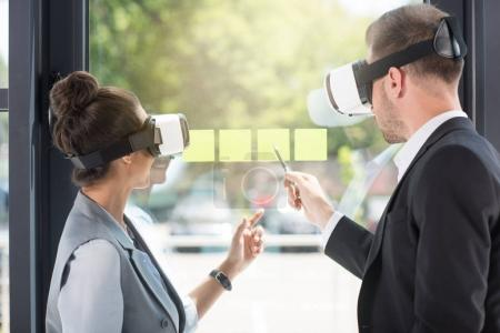 Photo for Business people wearing virtual reality headsets while working in office - Royalty Free Image