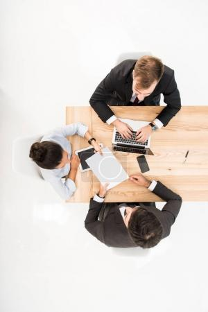 Photo for Overhead view business people having meeting isolated on white - Royalty Free Image