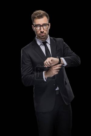 confident businessman with watch