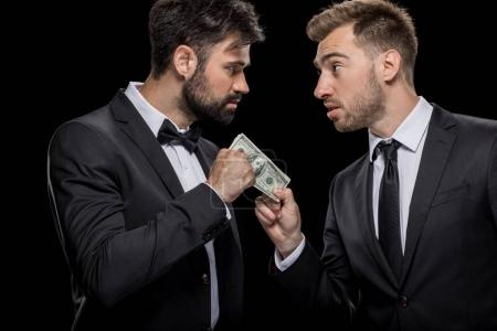 businessman bribing partner