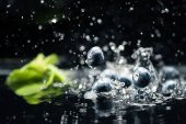 ripe blueberries dropping in water