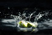 Slices of lime falling in water