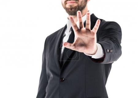 Photo for Cropped view of businessman showing stop symbol, isolated on white - Royalty Free Image