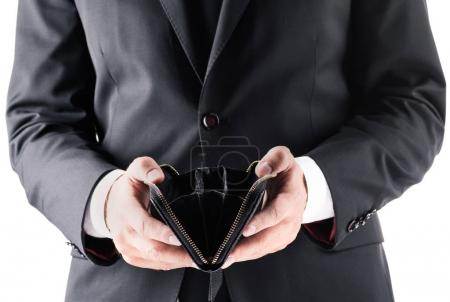 businessman holding empty wallet