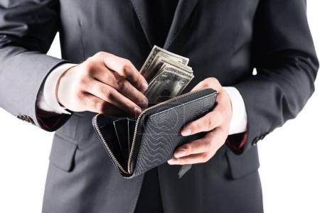 businessman holding wallet with dollars