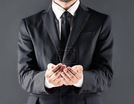 businessman with open hands