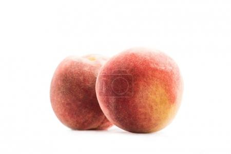 Photo for Close up view of fresh and ripe peaches isolated on white - Royalty Free Image