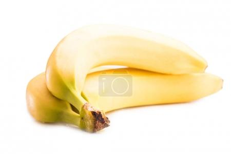 Photo for Close up view of fresh and ripe yellow bananas isolated on white - Royalty Free Image