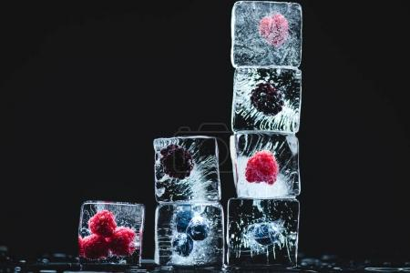 Photo for Close-up view of ripe juicy frozen fruits in ice crystals on black - Royalty Free Image