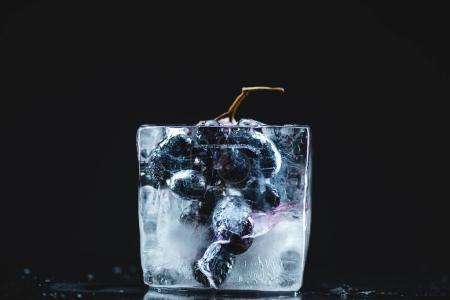 frozen grape in ice cube