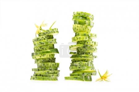 Photo for Two stacks of sliced fresh cucumbers isolated on white - Royalty Free Image