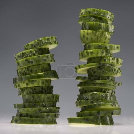 two stacks of sliced cucumbers