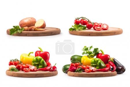 Photo for Collection of different fresh raw vegetables on wooden cutting board, isolated on white - Royalty Free Image