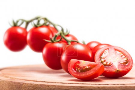 Photo for Fresh ripe cherry tomatoes on wooden cutting board isolated on white - Royalty Free Image