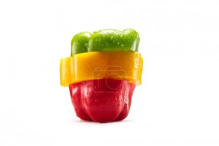 Photo for Slices of red, green and yellow bell pepper isolated on white - Royalty Free Image