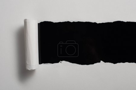 Photo for Blank ragged paper texture isolated on black - Royalty Free Image
