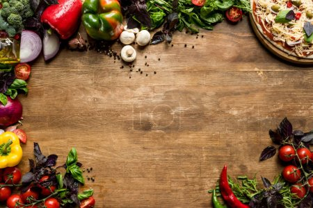 Photo for Flat lay with fresh vegetables and other pizza ingredients on wooden tabletop - Royalty Free Image