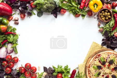 Photo for Top view of homemade italian pizza on wooden board with linen and various ingredients isolated on white - Royalty Free Image