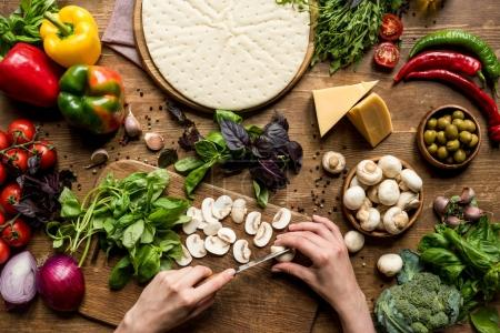 woman cutting mushrooms