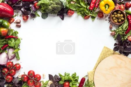 Pizza ingredients and wooden board