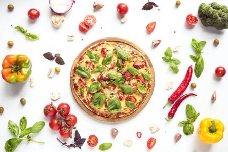 Photo for Flat lay with italian pizza on wooden board and various ingredients isolated on white - Royalty Free Image