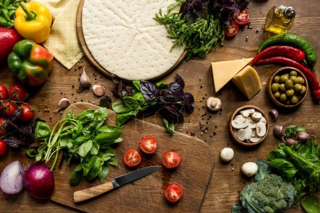 Pizza dough and fresh ingredients