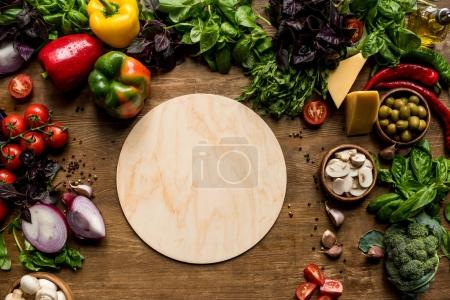 Photo for Top view of wooden board, fresh vegetables and herbs on tabletop with copy space - Royalty Free Image