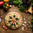 Top view of raw homemade pizza with cheese and fre...