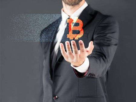 Businessman with bitcoin sign
