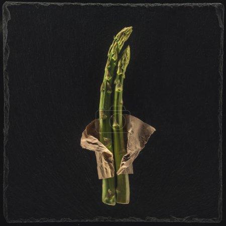 Photo for Organic fresh green asparagus on black - Royalty Free Image