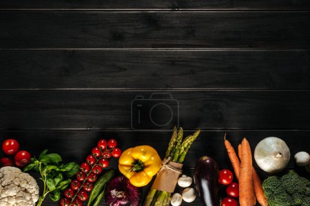 Photo for Different fresh vegetables lying in row on wooden tabletop with copy space - Royalty Free Image