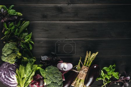 Photo for Top view of different fresh vegetables on wooden tabletop with copy space - Royalty Free Image