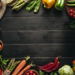 Frame of organic fresh vegetables on sacking on wo...