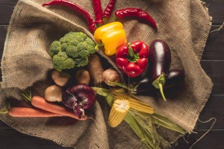 Ripe vegetables on sacking