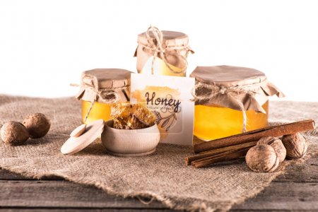 Honey in glass jars and card