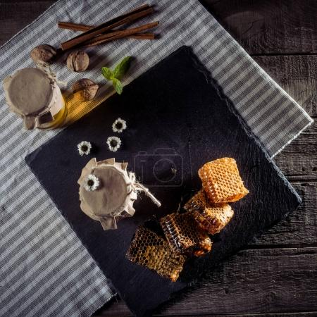 honeycombs and glass jars with honey
