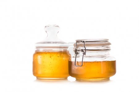 Fresh honey in glass jars